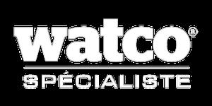 Photo grisée d'un entrepot, on voit le logo Watco et il est écit : Une gamme unique de produits pour les applications industrielles les plus exigeantes, spécialement formulée et conçue par Watco